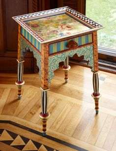 Nail frame to wicker table. Another beauty and one of my very favorites.the Teteria Table was inspired by romantic tea houses from remote parts of the world. Complete with beautiful Moorish architectural details. Whimsical Painted Furniture, Painted Chairs, Hand Painted Furniture, Funky Furniture, Art Furniture, Unique Furniture, Repurposed Furniture, Furniture Projects, Furniture Makeover