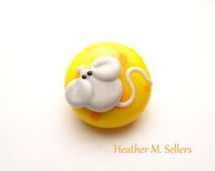Mouse and Cheese, a lampwork glass bead by Heather Sellers #cheesehead #greenbay…
