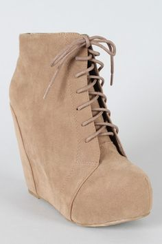 Lace up wedge bootie $35.50    With Skinny jeans and a big sweater for winter? Yes please. :)