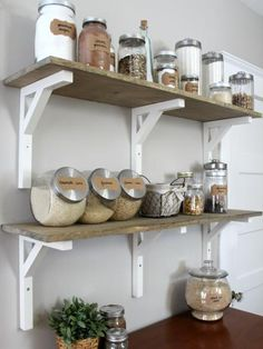 Instead of replacing the upper cabinets with new cabinets, the owners build open shelves using rustic pine boards and IKEA brackets. To complete the farmhouse look, they stain and seal the shelves with finishing wax.See more before-and-after photos of this kitchen at Christina's Adventures.