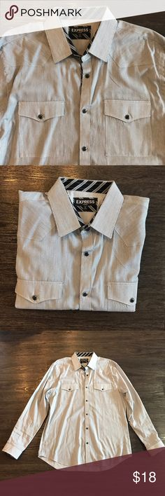 Express Stripped Button Down Thin stripped black and white long sleeve buttoned down shirt. Double front pocket. No stains or buttons missing. Worn only 3x. Express Shirts Casual Button Down Shirts