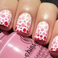 Love the different shades of pink used in this spotty nail art