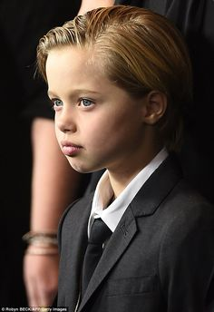 Like mother, like daughter, like father! Shiloh Jolie-Pitt looks the spitting image of Angelina and Brad  'Shiloh, we feel, has Montenegro style...She likes to dress like a boy.She wants to be a boy. So we had to cut her hair.  She thinks she's one of the brothers'