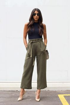 spring / summer - street style - street chic style - summer outfits - party outfits - casual outfits - black sleeveless crop top + olive belted culottes + military belted culottes + nude stilettos + black aviators + neutral toned shoulder bag