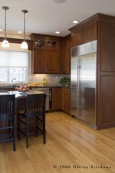 Love these cabinets paired with black furniture/ fixtures. Traditional Cherry traditional kitchen
