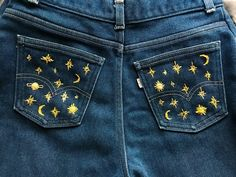 Measure size 31 waist x 32 pant leg Vintage dark blue wash Levi's Jeans! Hand embroidered with yellow astrological symbols; stars, moons, and Suns. One of a kind unique jeans!