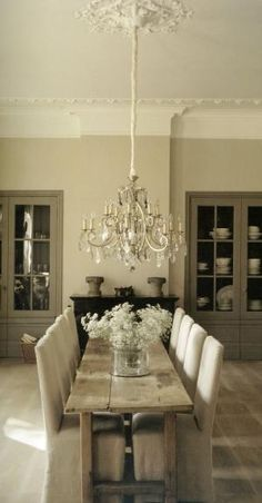 Rustic glam dining room with a low hanging chandelier. Love how the table is older, and the chairs make it look put-together. by pansy