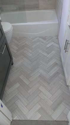 valentino tile in chevron pattern bathroom