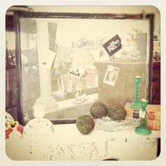 Use magnets to hold up photos on old window screens! Craft fair booth display idea brought to you by The Striped Pig, Fayetteville, Arkansas.
