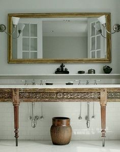 All Remodelista Home Inspiration Stories in One Place Wide mirror for double sink A carved sink console in a bath from the portfolio of Monica Bach. Master Bathroom Vanity, Wood Bathroom, Bathroom Ideas, Bathroom Vanities, Bathroom Renovations, Washroom, Bathroom Cabinets, Basement Remodeling, White Bathroom