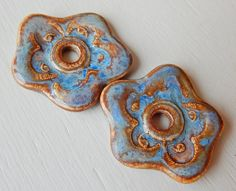 """2 Porcelain Earrings """" Blue&brown """"  Made with porcelain clay. They have flower shape and a beautiful design . Blue and brown glazes . Glazed front and back . Each measures 28 x 26 mm.  By Mª Carmen Rodriguez  https://www.facebook.com/groups/CeramicArtBeadMarket"""
