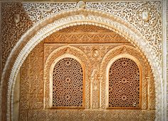 Alhambra • intricately carved walls and windows • Arabic roots in the Moorish period of Spain