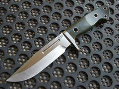 """Shane Sibert Knives, Gladstone, Oregon USA -Scout, : 6 1/2"""" blade 5 1/2"""" cutting edge 11 1/2"""" O.A.L 3/16"""" thick stock 410 S.S finger guard Average weight without sheath 13-13.5 OZ Edgeguard E.O.D kydex drop leg sheath with pouch standard."""