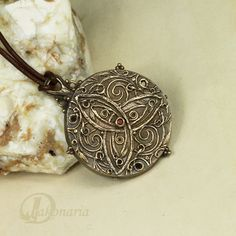 Bronze triquetra pendant. $115.00, via Etsy.