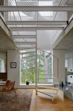 Metal grate flooring with skylight