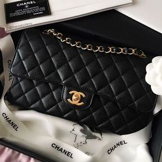 ab88743e17c61c Iconic, classic and forever timeless, the Chanel Flap Bag in medium, in  black caviar leather with gold hardware.