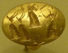 Anillo-sello de oro grabado con figuras femeninas. Minóico.