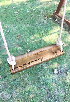 Never Grow Up Wooden Rope Swing | Dark Wood Tree Swing | Outdoor Wooden Swing | Outdoor Kids Swing | Outdoor Tree Swing | Toddler Swing This rectangle tree swing is made of polished cedar wood and measures 24 long x 6.5 wide x 1.75. Swing is inscribed with never grow up on the