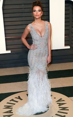 EMILY RATAJKOWKSI donned an ombré feather Johnathan Simkhai gown with diamonds by Arzano and Nigaam for the Vanity Fair after party.