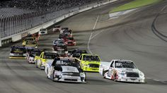 LAS VEGAS, NV - SEPTEMBER 29: Nelson Piquet Jr., driver of the #30 Qualcomm Chevrolet, leads the pack of trucks with Todd Bodine, driver of the #11 Toyota Care Toyota, during the NASCAR Camping World Truck Series Smith's 350 at Las Vegas Motor Speedway on September 29, 2012 in Las Vegas, Nevada. (Photo by Jeff Bottari/Getty Images for NASCAR)