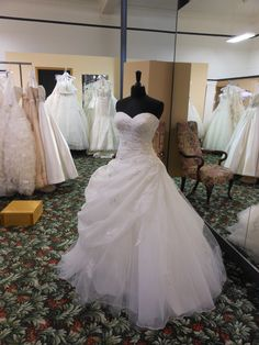 This strapless ballgown is really gorgeous! All the draping fabric and sweetheart neckline make it a princess's dream!