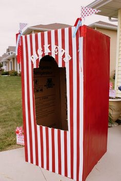 Carnival Refrigerator Box Ticket Booth - From Buckets of Grace, learn how to create your vey own ticket booth! {DIY Tip} If you don't have a large enough box lying around, contact your local appliance stores and ask for an empty refrigerator box that can once wrapped or painted in red and white stripes, can be decorated with little flags, bunting or even multicolored colored lights. Get the DIY here.