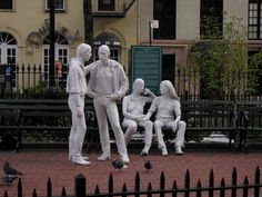 Christopher Square Park – Gay Liberation Monument - West Village - NYC - In 1979, Peter Putnam (1927–1987) a wealthy arts patron from Louisiana and trustee of the Mildred Andrews Fund, commissioned the Gay Liberation monument. The Mildred Andrews Fund had commissioned other contemporary sculptures: George Segal's Kent State Memorial and Richard Hunt's Harlem Hybrid. Segal, though not the first choice, accepted the commission, which stipulated only that the work 'had to be loving and caring…