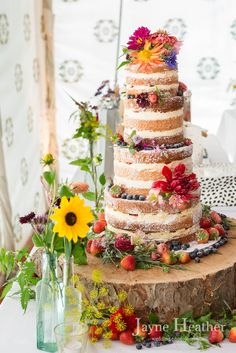 Naked wedding cake with fresh flowers and fruit - Anna & Mike's natural summer wedding at Wise Wedding Venue