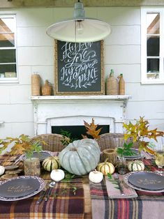 Cozy and rustic fall porch display this is the perfect setting for fall dinners. MODERN VINTAGE MARKET