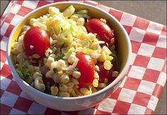 A fresh corn salad made with shallots, tomatoes, and basil.
