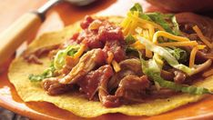 Top crisp tostada shells with a spicy chicken mixture that's slow-cooked to perfection - a delicious Mexican dinner.