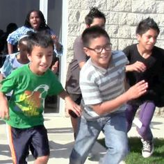 Kids laughing and striding at the Boys & Girls Club of Oxnard and Port Hueneme.