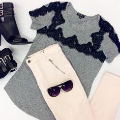 Wear this grey lace detailed tee with your go-to skinnies for an effortlessly cool look.