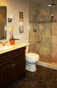 Bathroom:Gorgeous Remodeling Modern Bathroom Ideas With Wooden Vanity Along With Marble Countertops And Yellow Flower In A Pot And Toilet As Well As Glass Shower Area With Ceramic Tile Wall And Dark Ceramic Floo Captivating Monochromatic Style for the Up To Date Bathroom Remodeling