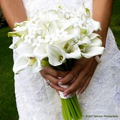 White calla lilies bouquet.  My favorite flower in the most beautiful arrangement.  This is exactly how I want my wedding bouquet to look like.