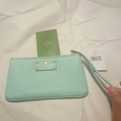 Kate Spade New York Zippered Chrissy Berkshire Brand new with tags New York Zippered Chrissy Berkshire wristlet in pretty pastel green color.  Crafted in a soft pebbled leather, it's perfectly sized to hold cash, lip gloss and your iphone when you're on the go.  Soft pebbled cowhide with matching trim.  Wristlet with a zip top closure. kate spade Bags Clutches & Wristlets