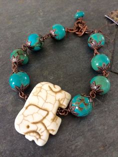 White and blue howlite elephant bracelet with copper.  Adjustable 7 3/4-9