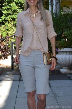 Classic casual: Grey, slim-fit shorts, soft blouse, gold Salvatore Ferragamo bag. ~JLJBackToClassic.com