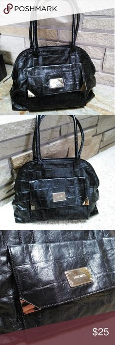 Nine West black embossed silver metal handbag Gorgeous nine west large handbag. Black embossed outter with silver metal accents. Has storage in outside and large zipped interior. Nine West Bags