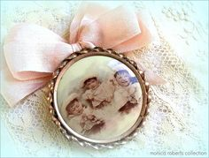 Very unusual, hand-coloured, antique celluloid memory/keepsake pin with three images ... could be a 'momento mori' but I don't think so. I own another with the portrait of an uncle at three and he lived for 81 yrs. Whatever it may be, it's one of the sweetest I've seen.