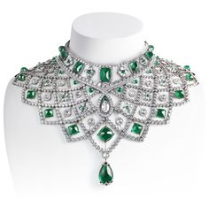 Faberge platinum emerald sugar loaf diamonds.