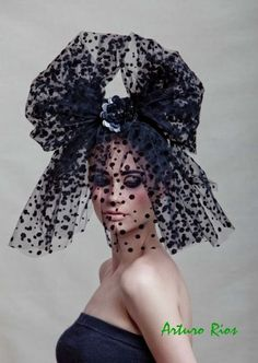 A headpiece from ArturoRios' Over the Top collection - handmade with antique veil with velvet polkadots seated on a oval pillbox and adorned with a black rose made of pailletes ~ I absolutely <3 this