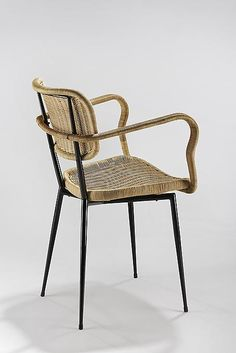 Janine Abraham and Dirk Jan Rol; Rattan and Enameled Metal Chair for Rougier, 1956.