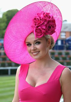 Welsh singer Katherine Jenkins poses for a photograph in her Philip Treacy hat as she arrives on the first day of Royal Ascot 2009 at Ascot Racecourse on June 16, 2009 in Ascot, England. #passion4hats