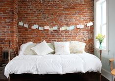 I'm not usually a fan of exposed walls in the bedroom... but I quite like this.