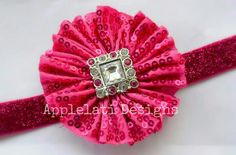 This Sequin Flower is attached to a lined hair clip and comes with a interchangeable headband.  Flowers can be worn with the headband or alone as a broach or in the hair alone  All ribbon has been heat sealed to prevent fraying. Headband measures approximately 5/8 inches wide. Please note you...