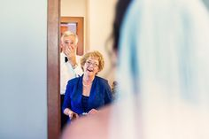 Emotional wedding day moment for brides parents - first look