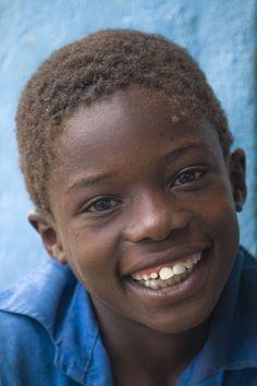 Photograph of Big smile of a Malawian boy near Mulanje mountain - Malawi - Africa  by www.traveladventures.org