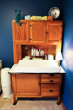 Alayna's Nursery Tour - Deep colors, bright patterns and vintage travel theme.  Antique Cabinet as changing table.