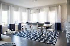 Modern & Sleek Nautical Interior Design by Canadian Interior Designer, Natalie Fuglestveit Interior Design.  Featuring Nautical Dining Room.